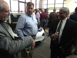 Dennis Murphey, with the City of Kansas City, chats with Tom Corso with MC Realty and Ashok Gupta with the NRDC at the recent KCP&L news conference announcing 1,000 new charging stations.